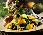 Strips of fried pumpkin with spinach, with lamb cutlet