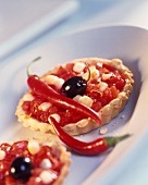 Spicy tomato and chili tartlet with olive and mozzarella
