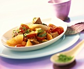 Lamb ragout with grapefruit, cherry tomatoes and courgettes