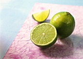 Whole lime, lime half and wedge