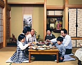 Japanese family eating at home