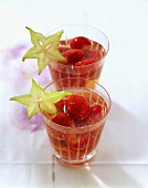 Strawberry punch in glasses with slices of carambola