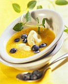 Cold peach soup with semolina dumplings and blueberries