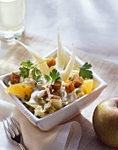 Celery and Chinese cabbage salad with fruit and croutons