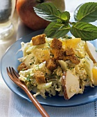 Celery & Chinese cabbage salad with orange, apple & croutons