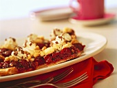 Cherry crumble tarts with cream and grated chocolate