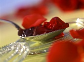 Redcurrant and rose petal jelly on spoon