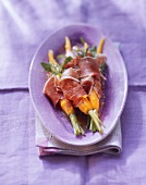 Rocket, ham & carrots on purple plate