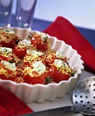 Tomato with pasta stuffing, cream cheese and chives