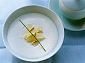 Creamed asparagus soup with pine nuts