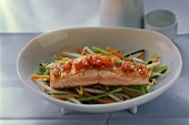 Salmon fillet with tomatoes on julienne vegetables