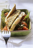 Trout provençale with tomato ragout in green bowl