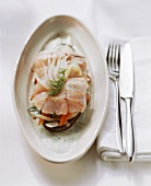 Nile perch fillet on mixed vegetables with dill