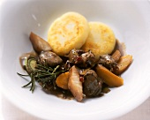 Venison ragout with potato cakes and rosemary