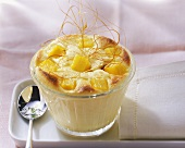 Mango and quark pudding with vanilla and caramel strands