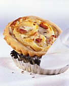 Onion tart with bacon on baking tins