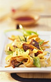 Rice noodles with strips of duck and vegetables