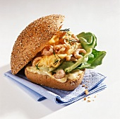 Roll with shrimp scrambled egg and lettuce leaves