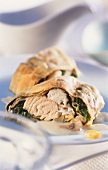 Fish strudel with spinach and lemon sauce