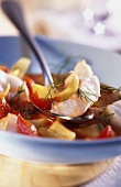 Fish stew with peppers, onions and dill