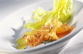 Smoked salmon with lettuce leaf, pepper and dill