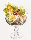 Waldorf salad with pineapple and walnut kernels