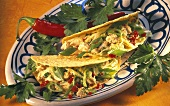 Tacos with chicken salad and chili