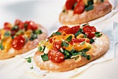 Tomato tartlet with processed cheese and herbs