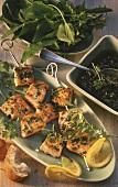 Salmon kebabs with wild herb pesto