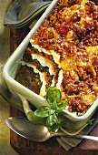 Spinach lasagne with mince in baking dish