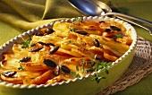 Sweet potato gratin with carrots and pumpkin seeds