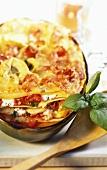 Artichoke lasagne with tomatoes and ham