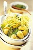 Courgette ragout with potato gnocchi and lettuce