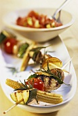 Barbecued vegetable kebabs with rosemary; tomato salsa