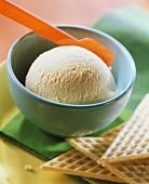 Caramel ice cream in blue bowl