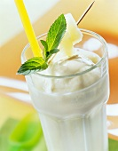 Pineapple milk with ice cream and lemon balm