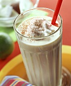 American egg nog, garnished with beaten egg white & cocoa
