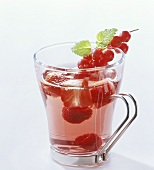 Punch with various berries in glass