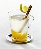 Citrus punch with cinnamon stick in glass