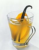 Punch with orange peel and cinnamon sticks