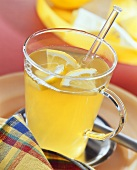 Green tea punch with lemon slices in glass cup