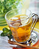 Apple and herb tea punch in glass cup