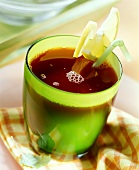 Red wine punch in green glass with lemon slices