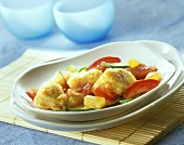 Sweet & sour fish with vegetables & pineapple cooked in wok
