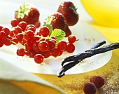 Fresh berries, vanilla pods and brown sugar