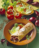 Chili con carne wrap with iceberg lettuce, tomatoes & sweetcorn