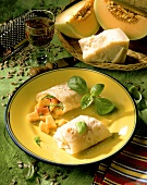 Wrap with parma ham & melon filling, basil and parmesan