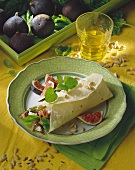 Fig, goat's cheese and salami wrap with pine nuts