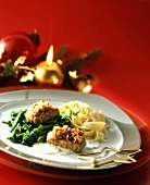 Pork medallions on spinach with ribbon noodles