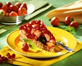 Piece of berry gateau on yellow plate; fresh strawberries